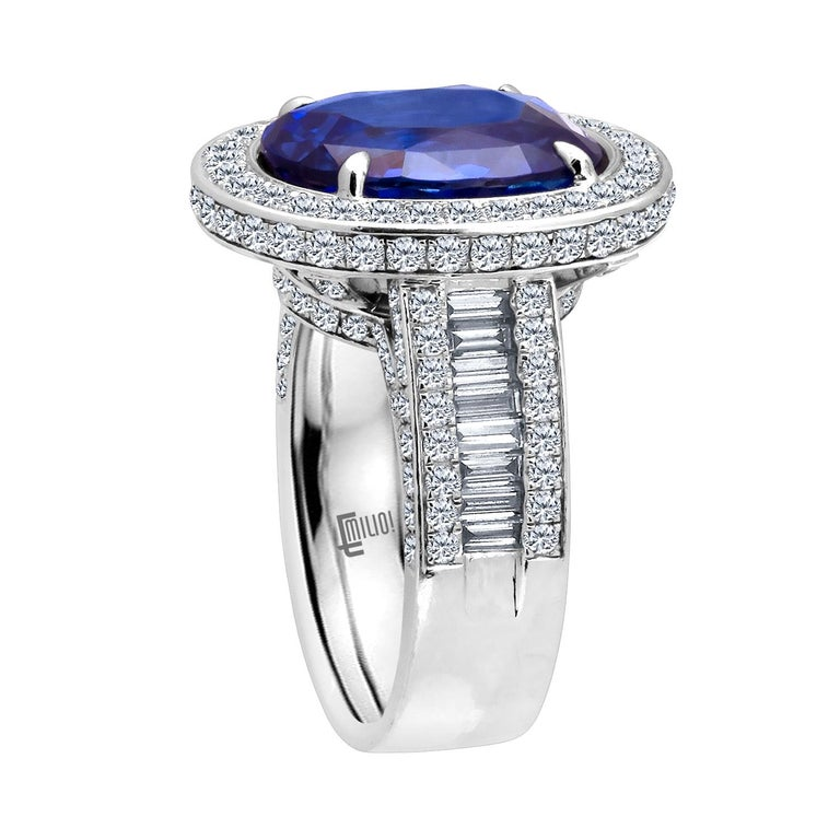 Hand made in the Emilio Jewelry Factory, A gorgeous rich blue Certified Ceylon No Heat Unheated Sapphire certified by GRS weighing 9.92 Carats set in the center. The Sapphire clarity is exceptional our opinion a vs1 clarity  and completely eye