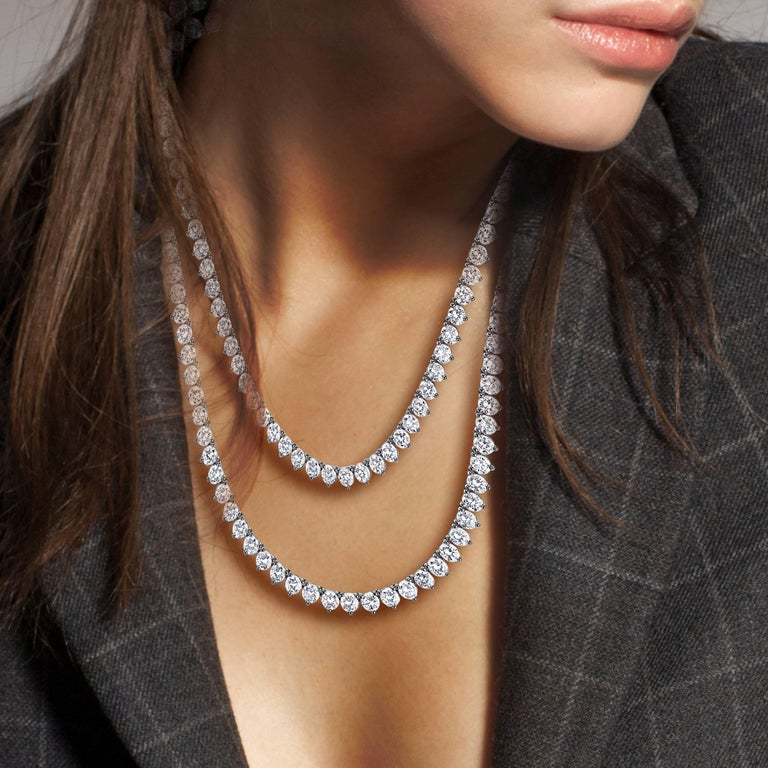 Natural White Round Diamonds Set In a 3 Prong Emilio! Setting. This stunning classic opera necklace can be worn long 34 inches, or wrapped around the neck twice and worn as a double short necklace!  Color: E-F Clarity: VS Cut: Excellent  APP carat