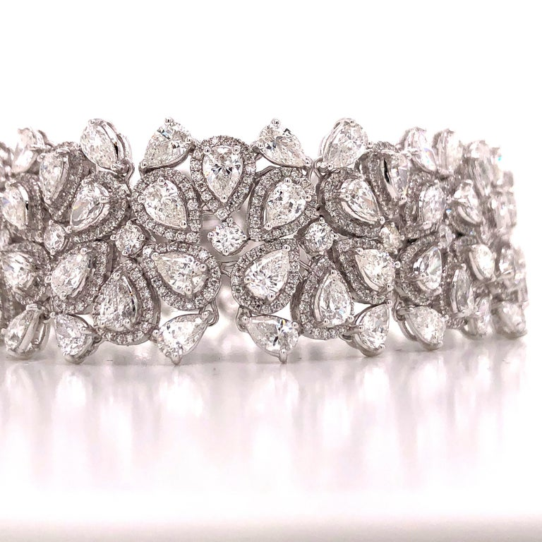 Hand made in the Emilio Atelier this bracelet is 21mm wide and 7 inches long. 265 pear shape and round diamonds totaling approx 22.20 carats of diamonds. Set in 18k white gold.  Color: E-F  Clarity: Vvs1-Vs2 overall  Professional appraisal included