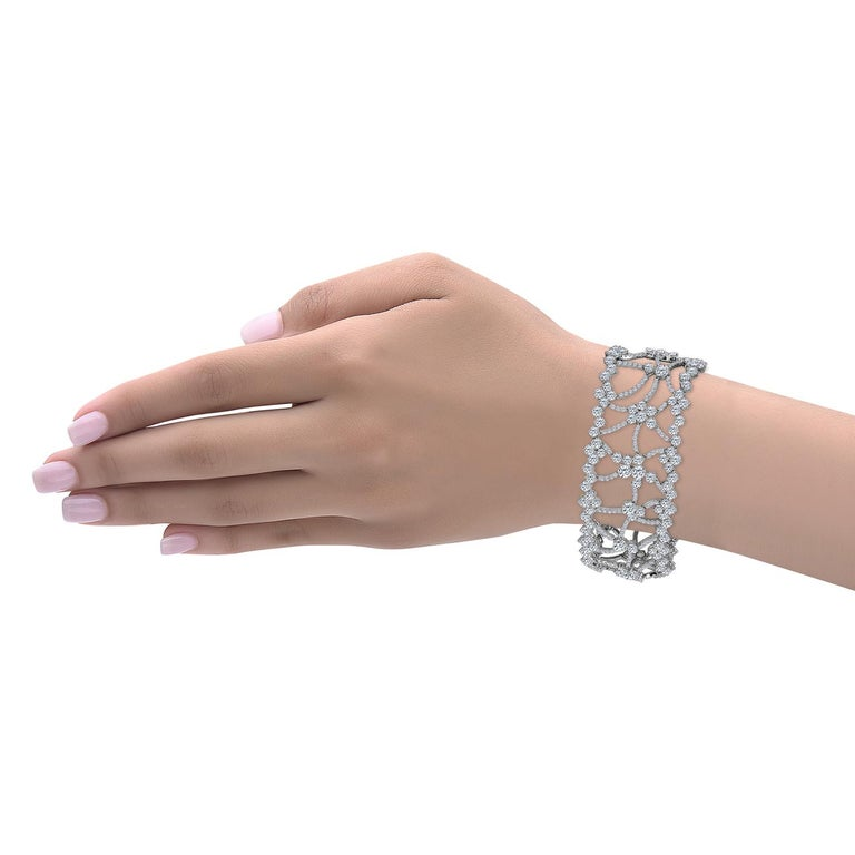 Hand made in the one and only Emilio Jewelry factory this diamond bracelet is wide enough to impress and yet classy elegant. Approximately 23.03 Carat of mixed sized diamond from .35ct each down to .05ct make up this unique bracelet. The width is