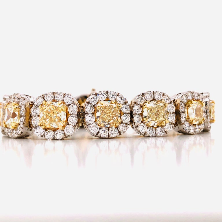 Featuring just 15 yellow diamonds totaling a whopping 22.93 carats, the average weight of each yellow diamond is approx 1.52 carats! The bracelet width is about 11.70mm wide with the yellow diamonds averaging about 6.30mm. The diamond clarity