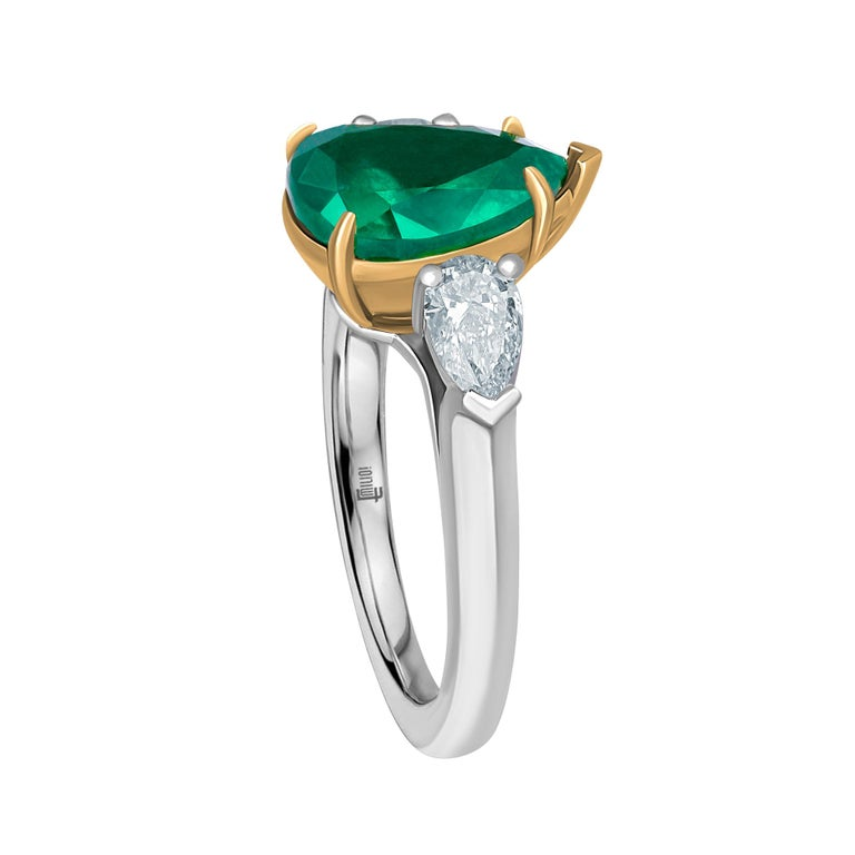 Showcasing a pear shape 2.42ct Genuine Emerald certified by C.Dunaigre as Zambian origin. The color has been certified as Vivid green, the most desirable color in emeralds. Based on emerald grading methodology the clarity of the emerald is
