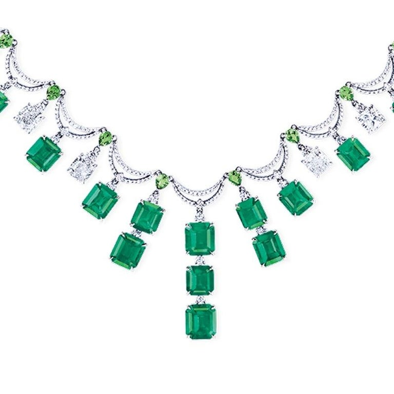 Showcasing Vivid green Muzo color Colombian emeralds certified by Grs, you will be awed by how striking and perfectly matched these rare emeralds are.  Approximately 28 carats of emeralds (each emerald is certified please inquire)  and 8ct diamonds