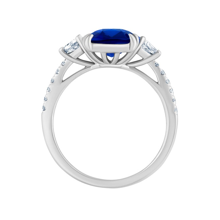 Emilio Jewelry 4.24 Carat Vivid Blue Sapphire Diamond Ring  This amazing ring is unique and well thought out before Emilio designed it! Most women today want a ring that is striking, yet humble enough to wear to perform everyday errands. This ring