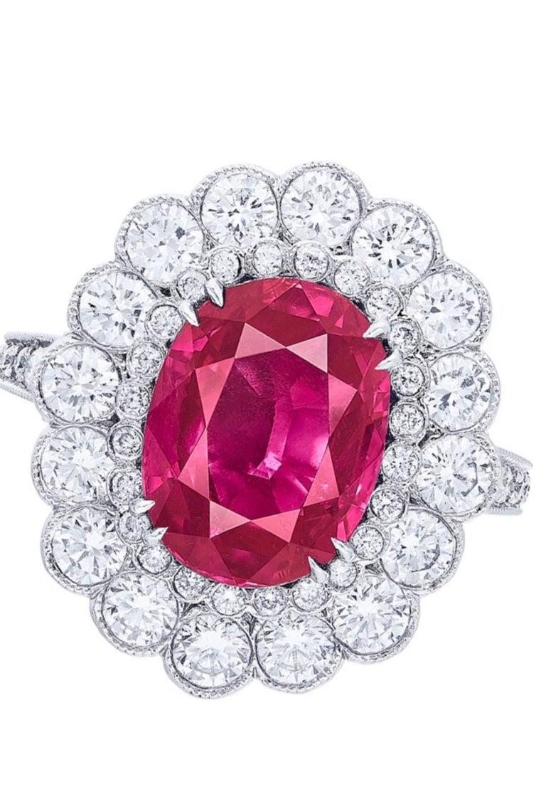 Showcasing a Grs Certified 6.00 carat Mozambique untreated Ruby.  The color is vivid red Pigeons blood red which is the most desirable, rarest, best color available in rubies. The approximate total weight of this ring is 8.20 carats. This piece was