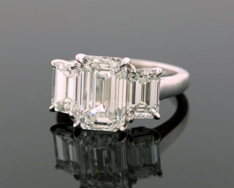Hand made in the Emilio Jewelry factory, this ring is a superb example of the finest life has to offer!  All 3 diamonds are GIA certified. Copies of the certificates are found in the images.  Center Diamond: 4.13ct emerald cut E color Vs2 Clarity