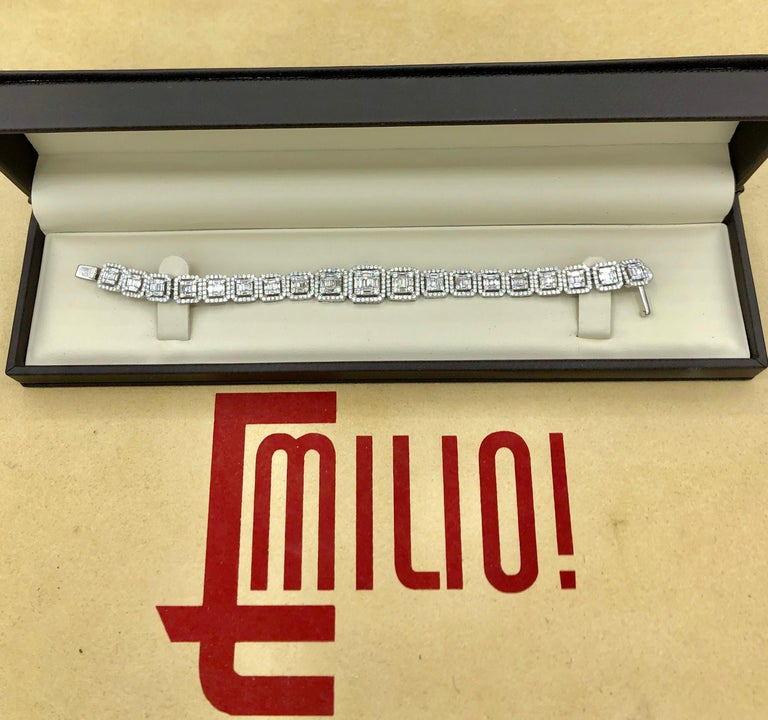 Hand made in the Emilio Jewelry Factory. Here are the details Metal: 18k Natural Diamonds: 6.21 carats of round, and baguette diamonds to create an illusion of large single stones.  Color/Clarity: E color Vvs1 clarity  Cut: excellent  length: 7