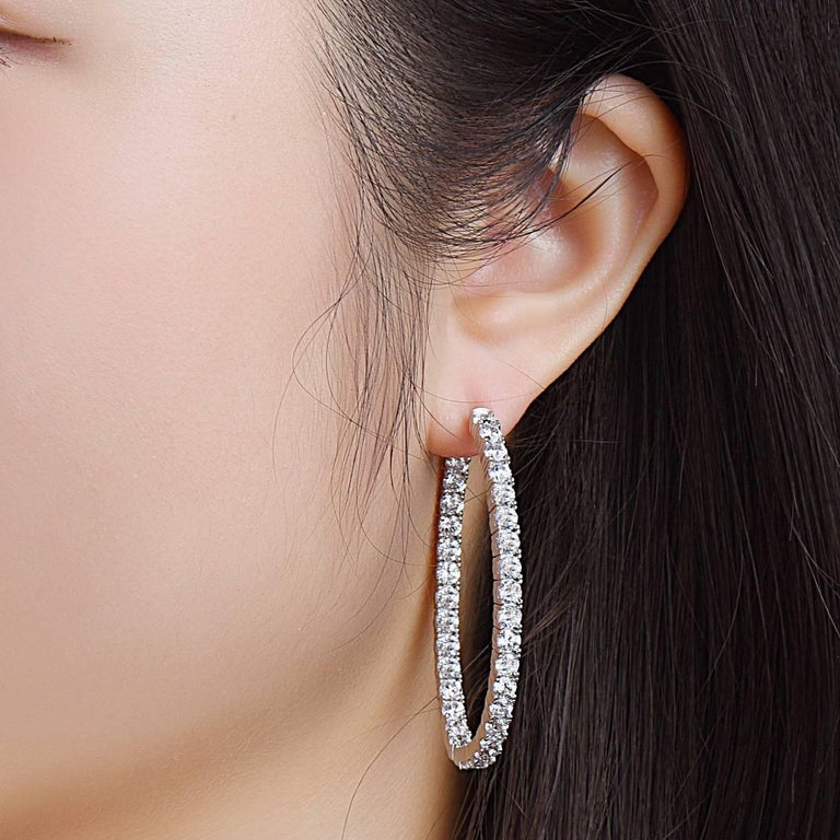 Oval Shaped Inside Out Diamond Hoop Earrings Set With Round Diamonds From The King Of Hoops