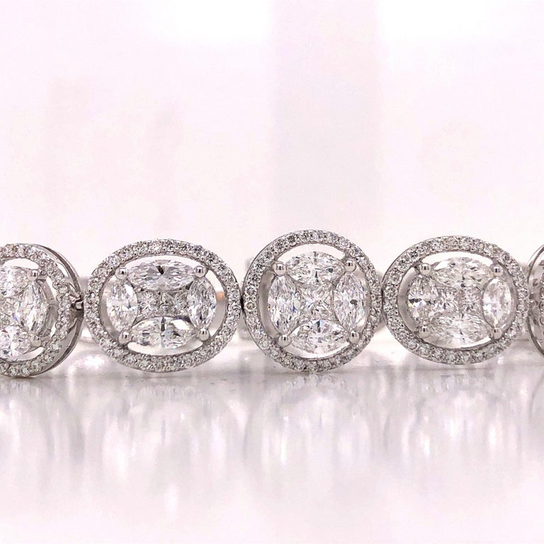 Hand made in the Emilio Atelier this bracelet features 510 Marquise, princess, and round diamonds to create and effect of large oval shaped and large round shaped diamonds alternating and graduating. It is 7 inches long and graduates from 9mm wide