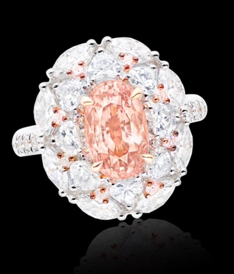 From the Emilio Jewelry Vault, We are Showcasing a stunning 3.00 carat Grs Certified orangy pink unheated Padparascha center. Please inquire for more images, the certificate, diamond weights, or appraisals. Custom re-design available. Video