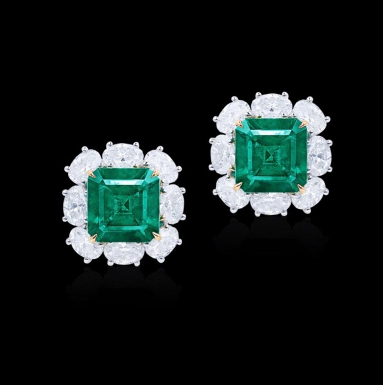 From the Emilio Jewelry Museum Vault, We are Showcasing a stunning pair of 6.00 carat total weight untreated no oil emerald earrings. The diamonds are exceptional and clean. No oil Colombian vivid green Muzo emeralds are extremely rare making up for