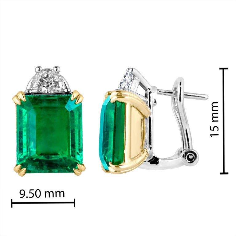 Hand made in the Emilio Jewelry Factory, 2 gorgeous bright rich emerald cut Zambian Emeralds wh 9.07 Carats set in the center. The emeralds are exteremely clean and completely eye clean.  Center Emerald Dimensions: 11.30mm long X 9.50mm wide  The