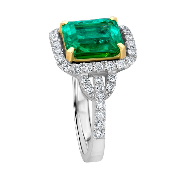 This ring was created by Emilio Jewelry in 18k white gold and the center stone is Certified as a Colombian Emerald. The color of the emerald is very attractive bright green and the stone is very pleasant being that it is eye clean. Center weight: