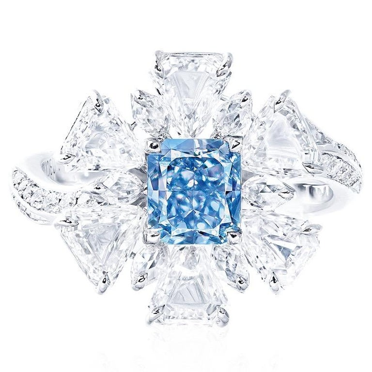 From The Museum vault at Emilio Jewelry New York, Main stone: 1.00 carats Fancy pure Blue diamond center with no overtone.  Setting: 28 white diamonds totaling approximately 0.15 carats, 6 white diamonds totaling approximately 1.77 carats, 6