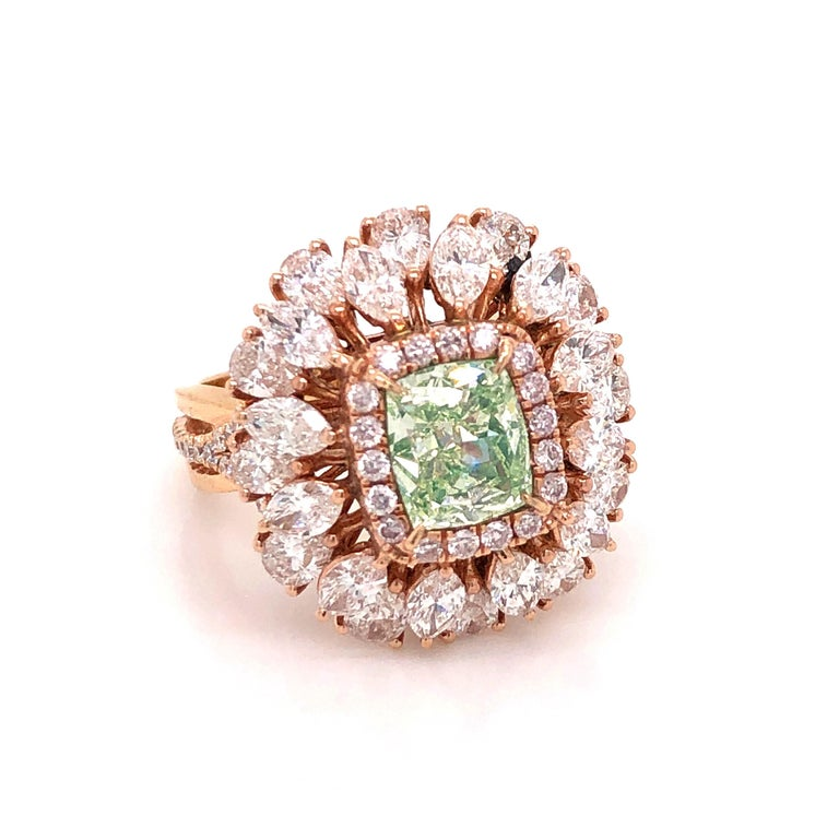 Showcasing a spectacular GIA certified 1.68 Carat Natural fancy L. Green diamond center with excellent saturation throughout. The clarity is si1 and an exceptionally clean diamond. Simply send us a message to request a copy of the GIA report. With