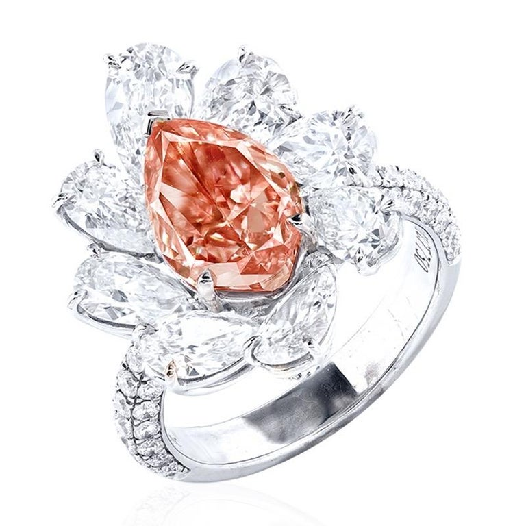 From the Emilio Jewelry Museum Vault, Main stone: 3.00 carats Fancy Intense Orangy Pink VS2 PEAR Setting: 74 white diamonds with a total of about 0.77 carats, 8 white diamonds with a total of about 3.149 carats, 18K From a historical perspective,