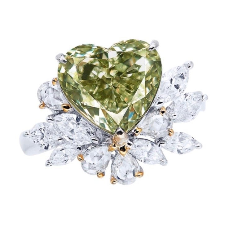 Showcasing a very special and rare natural 4carat fancy green diamond ring certified by GIA. We are proud to showcase one of the very few if any at all in this size on market. Hand made in the Emilio Jewelry Atelier, whom specializes in rare