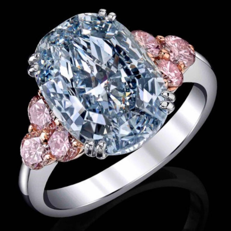From the Emilio Jewelry Museum Vault, We are Showcasing a stunning 6.00 carat Gia certified natural blue diamond center. Natural fancy blue diamonds are the rarest of all colors.The diamond is exceptional and clean. This piece was Hand made in the
