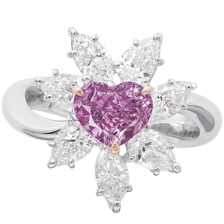 Showcasing a Gia certified 1 carat + natural fancy intense green pinkish purple diamond of exceptional purple color. The primary color according to Gia is natural purple. Natural purple diamonds are the rarest of all colors.  This piece was Hand