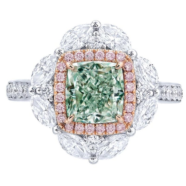 From the Museum vault at Emilio Jewelry in New York, Main stone: 2.00 carats Fancy Light Green. Pure green color with no overtone makes this diamond ring special enough to put inside the Museum vault.  Setting: 24 pink diamonds with a total of about