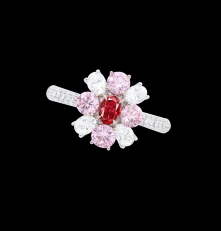 From the Emilio Jewelry Museum Vault, Showcasing a stunning certified .30ct carat Gia certified natural fancy pure red diamond set in the center.  We are experts at creating jewels for these very special collectible diamonds. If you have another