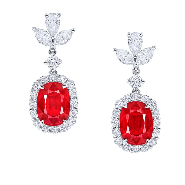 Two center rubies: 2.13 carats Vivid Red OVAL, 2.08 carats Vivid Red OVAL Setting: 4 fancy-cut marquise white diamonds with a total of about 0.47 carats, 2 fancy-cut water drop white diamonds with a total of about 0.31 carats, 34 round white