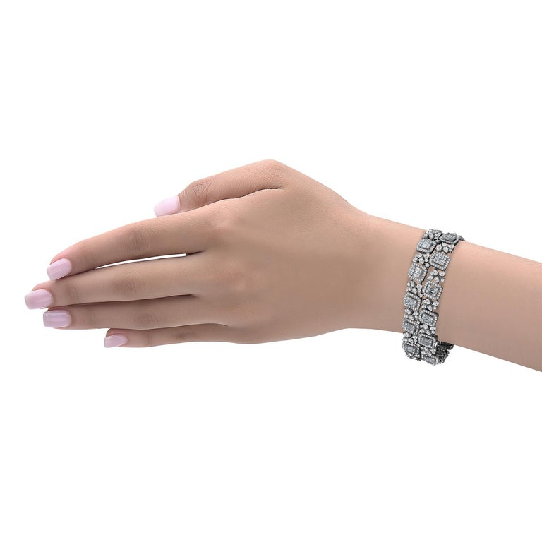 Hand made in the Emilio Atelier this 20mm wide diamond bracelet features a mix of baguette, pear shapes, and round diamonds to create a stunning effect. Approximately 940 diamonds in total and the approx diamond weight is 14.00 carats.  Color: E-F