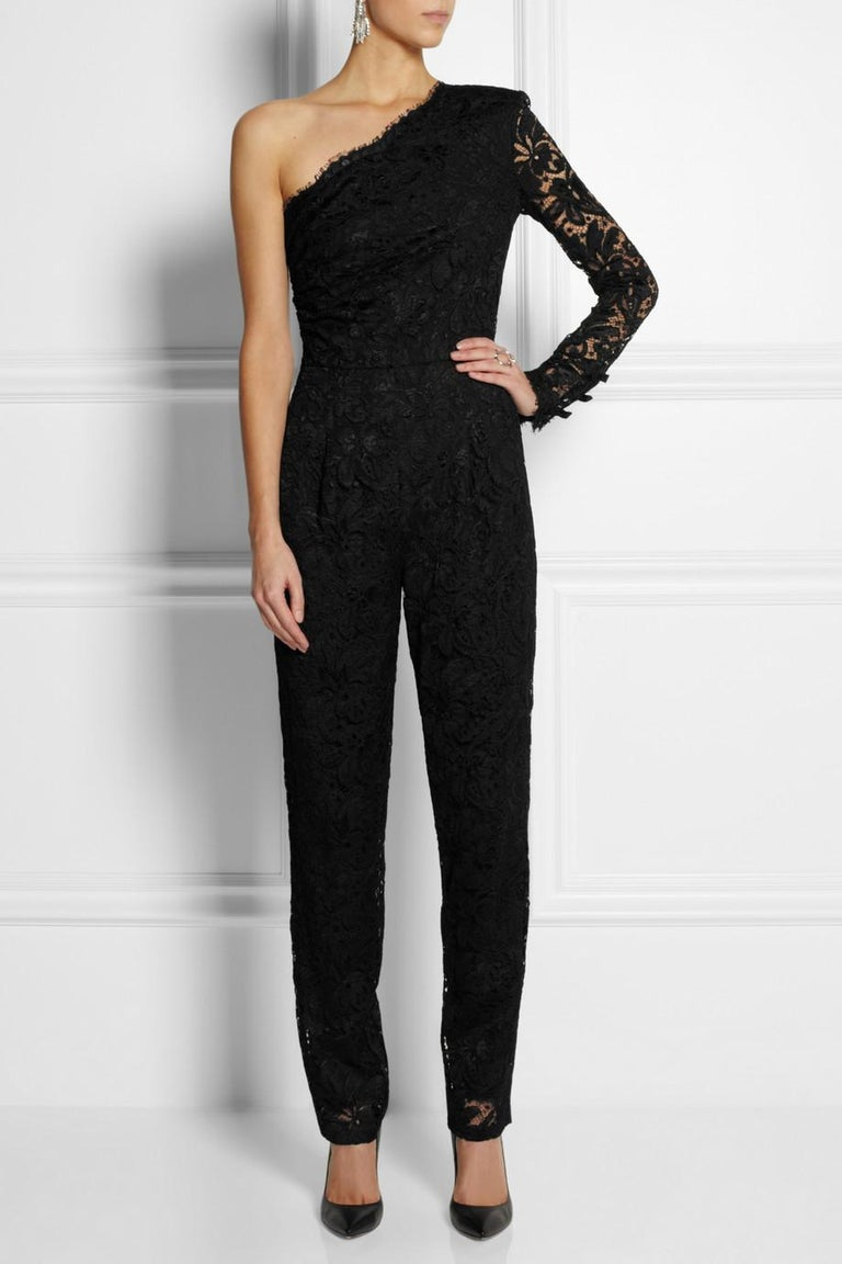 Amazing piece by  Peter Dundas for Emilio Pucci  Designer Peter Dundas referenced the glamor of the late '60s and early '70s for the Emilio Pucci his collection. Cut with a single shoulder, this black lace jumpsuit is tailored for a close fit and