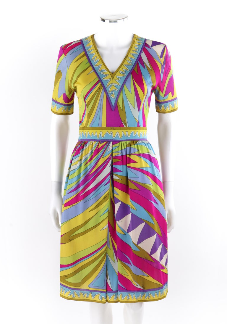 EMILIO PUCCI c.1960's Abstract Stripe Op Art Signature Print V-Neck Sheath Dress   Circa: 1960's Label(s): Neiman Marcus Trophy Room Designer: Emilio Pucci Style: Sheath dress Color(s): Shades of pink, purple, green, blue, yellow, white Lined: