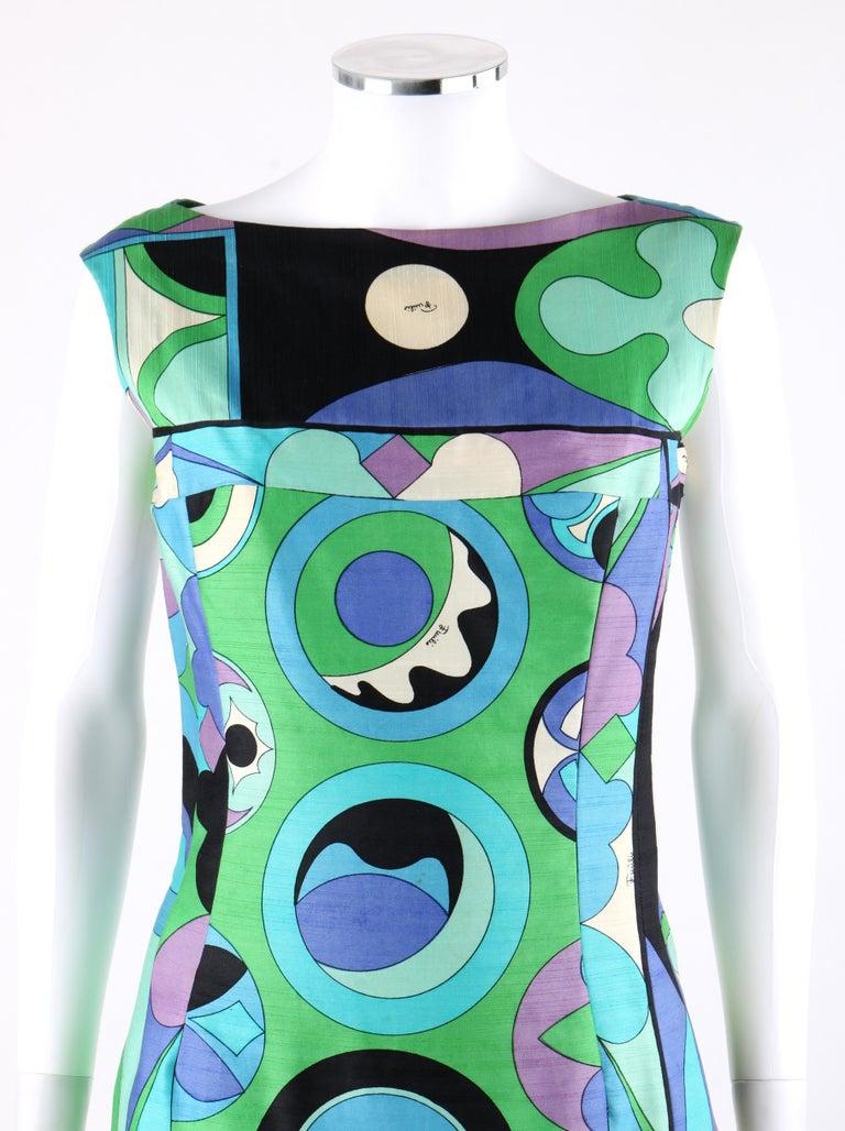 EMILIO PUCCI c.1960's Green Blue Op Art Signature Print Sheath Dress   Circa: 1960's Label(s): Emilio Pucci  Style: Sheath Dress Color(s): Shades of green, blue, purple, white and black.  Lined: No Marked Fabric Content: 100% Cotton  Additional
