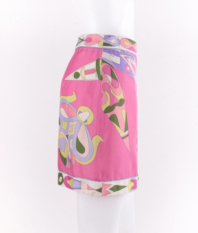 EMILIO PUCCI c.1970's Pink Multi-color Signature Print Silk Wrap Skirt   Circa: 1970's Label(s): Emilio Pucci  Style: Wrap mini skirt Color(s): Shades of pink, purple, white, green and yellow.  Lined: No Marked Fabric Content: 100% Silk  Additional