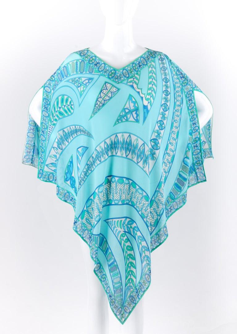 DESCRIPTION: EMILIO PUCCI c1970s Signature Print Silk Chiffon Beach Cover Poncho Scarf Blouse   Circa: c1970's  Label(s): Emilio Pucci; Saks Fifth Avenue Emilio Pucci Boutique  Style: Beach cover/poncho   Color(s): Multi with shades of aqua blue,