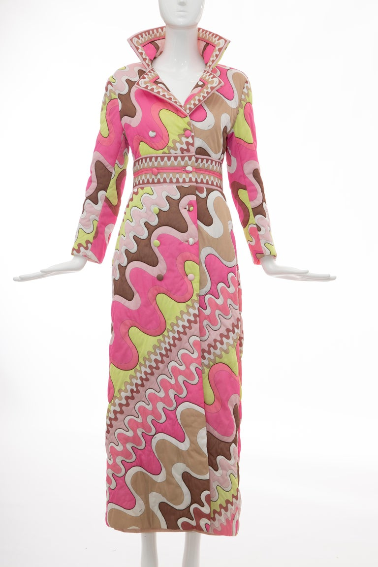 Emilio Pucci Formfit Rogers, Circa: 1970's long double-breasted quilted polyester coat with abstract print throughout, notched lapels, dual seam pockets and button closures at front.  Small Bust: 36, Waist: 31, Shoulder: 16, Length: 53, Sleeve: 28