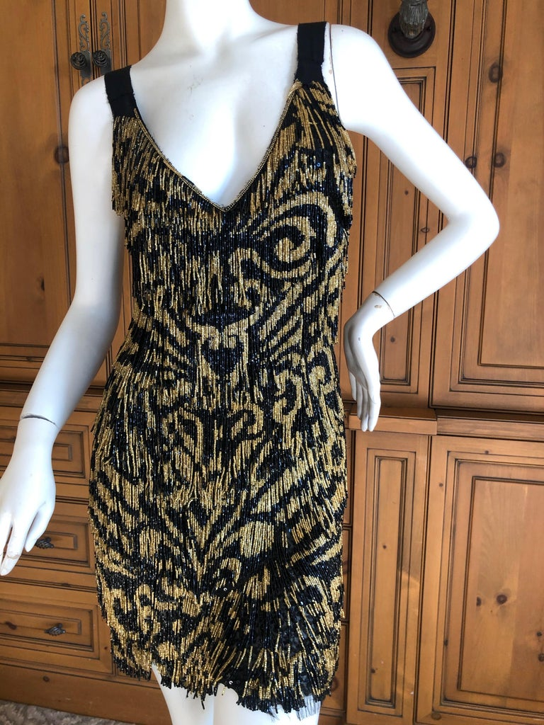 Emilio Pucci Flapper Style Black & Gold Beaded Fringe Mini Dress.  WOW , this is so fun.  These are glass beads, and this weighs a lot, so not for the faint of heart. Size 40 / 6 US  Bust 35