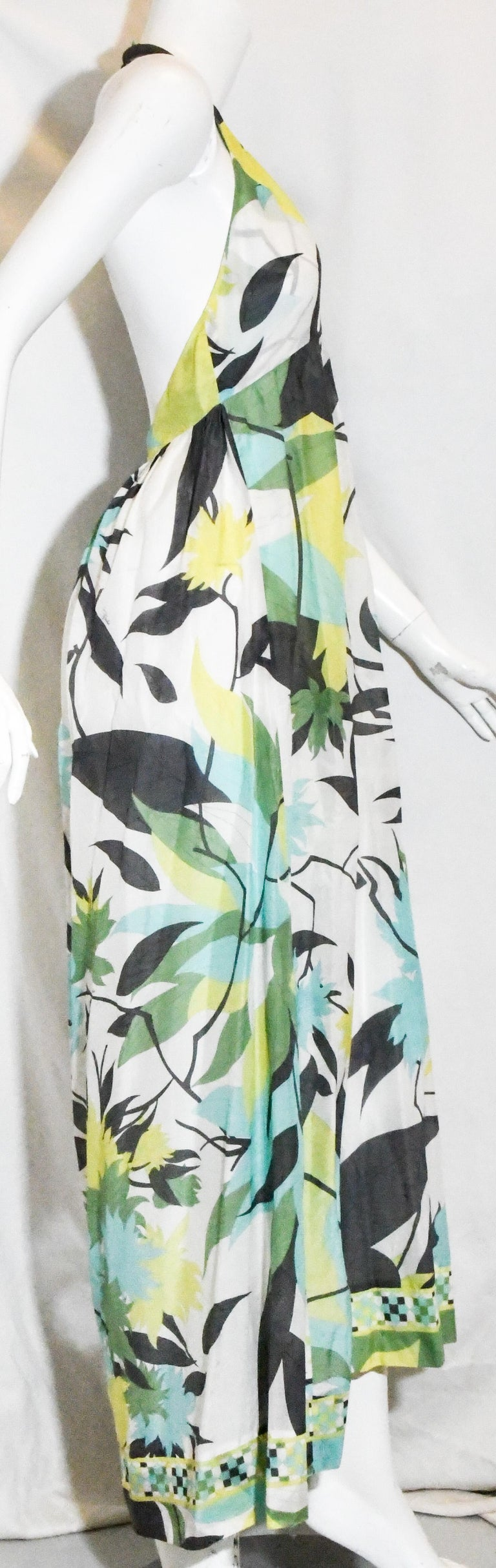 Emilio Pucci halter V neck abstract floral print dress with bare back and asymmetric hemline.  This dress is shorter at front with gathered skirt.  Enjoy this dress for day or night, casual and classy.   Dress is in excellent condition.  Made in