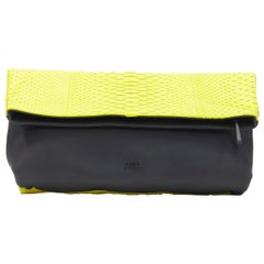 EMILIO PUCCI neon yellow scaled pleather black rubber fold over clutch bag