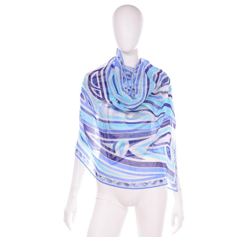 This Emilio Pucci scarf is brand new and comes with its original box! The abstract blue print fabric is 65% Linen and  35% Cotton. Made in Italy.  LENGTH: 72