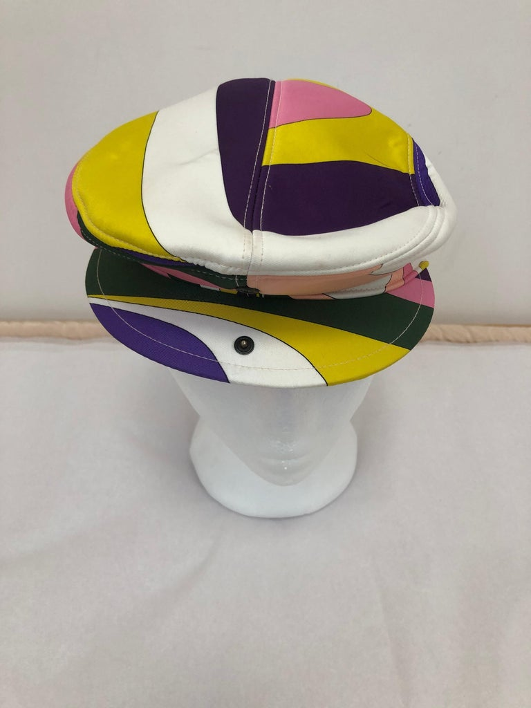 Newsboy cap with a difference as there is a snap in front which allows you to extend the hat. It is an iconic Pucci print and very versitile.