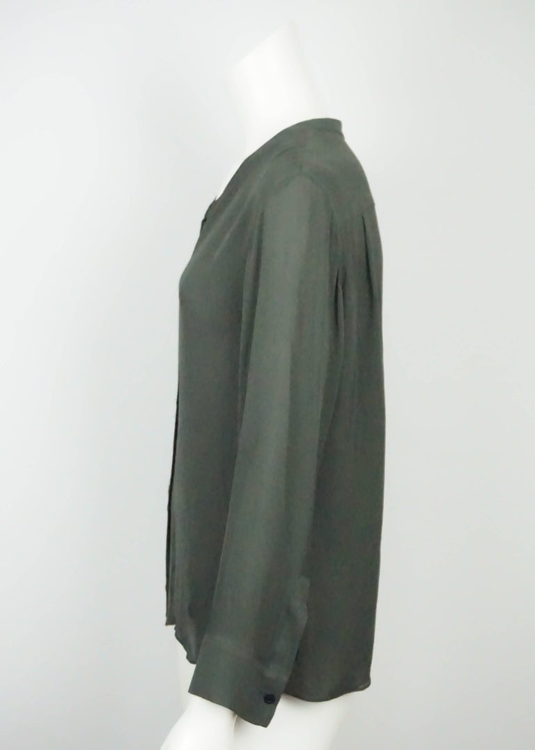 Emilio Pucci Olive Silk Chiffon L/S Top - 34  This silk top has long sleeves, buttons down the front with a low mandarin collar. Sleeves have cuffs with one button. The back has two small pleads and its in excellent condition. Measurements: Shoulder
