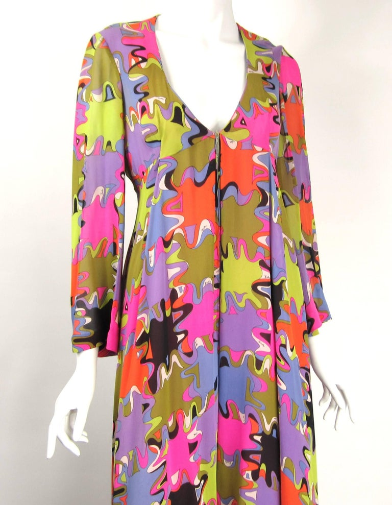 The colors on this vintage Pucci are AMAZING! Massive Wide legs on this one. Zips up the front with bell sleeves, lined pant legs. Measures. Up to 36-inch bust. Has an Empire waist. Open Hips. 42-inch wide leg laying flat. Will fit a Med-large.