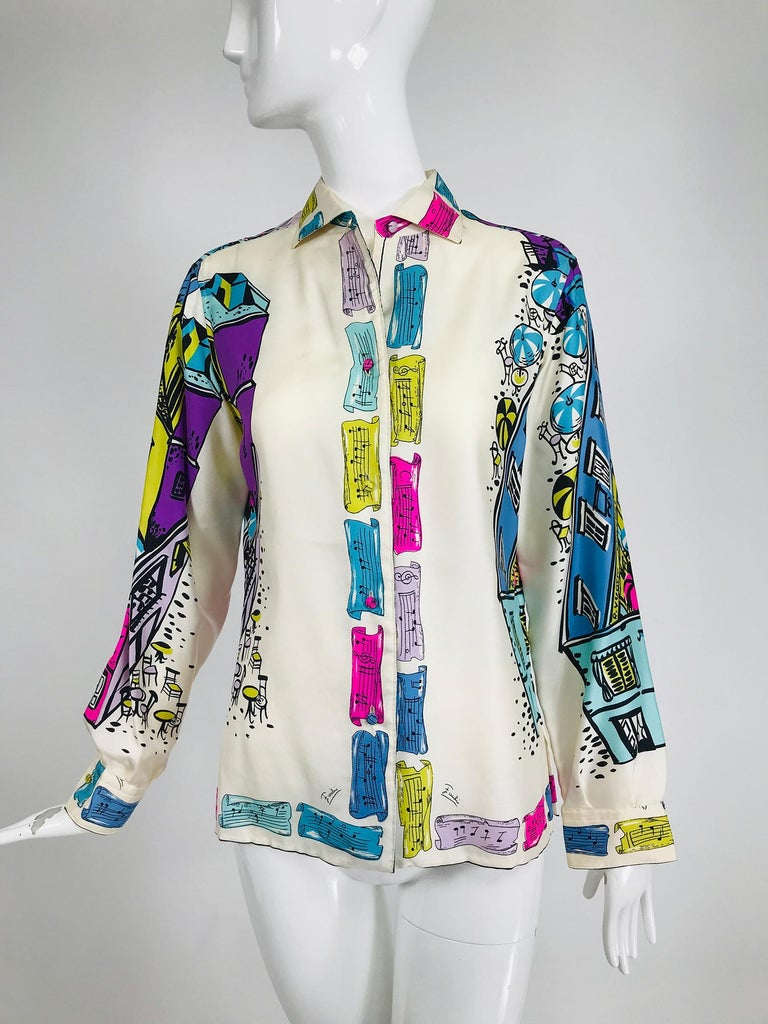 Emilio Pucci rare silk twill print Italian cafe blouse 1960s, made expressly A.S. Coopers, Bermuda. A fabulous print in vivid colours, the front facings are musical notes, the sleeves and back are cafe nightlife, shops including Pucci and striped