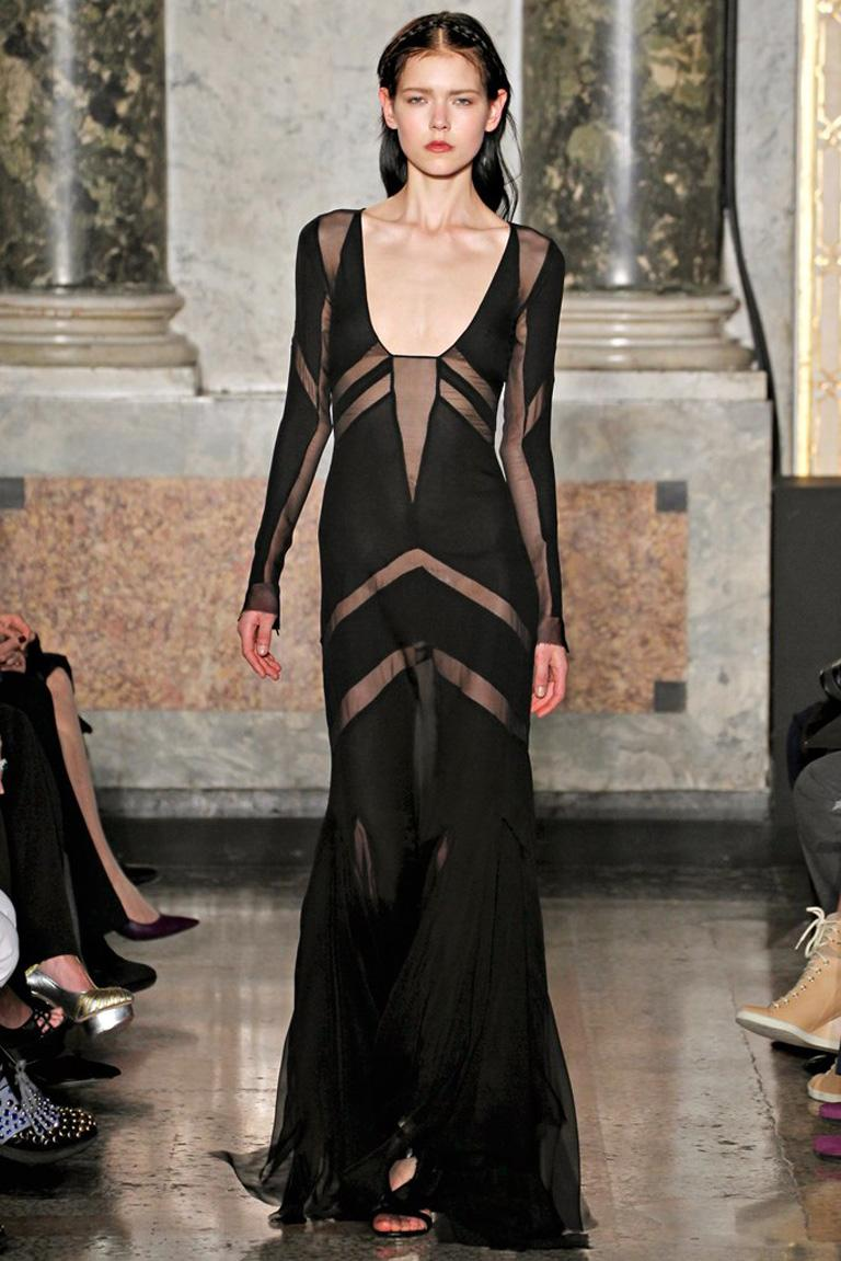 Emilio Pucci showstopping sexy sheer black gown.   Fashioned of silk in a  bias cut silhouette; with godet panels extending into raw cut edges at lower hemline. Additionally boasts, strategically placed panels throughout the garment.   Fully lined.