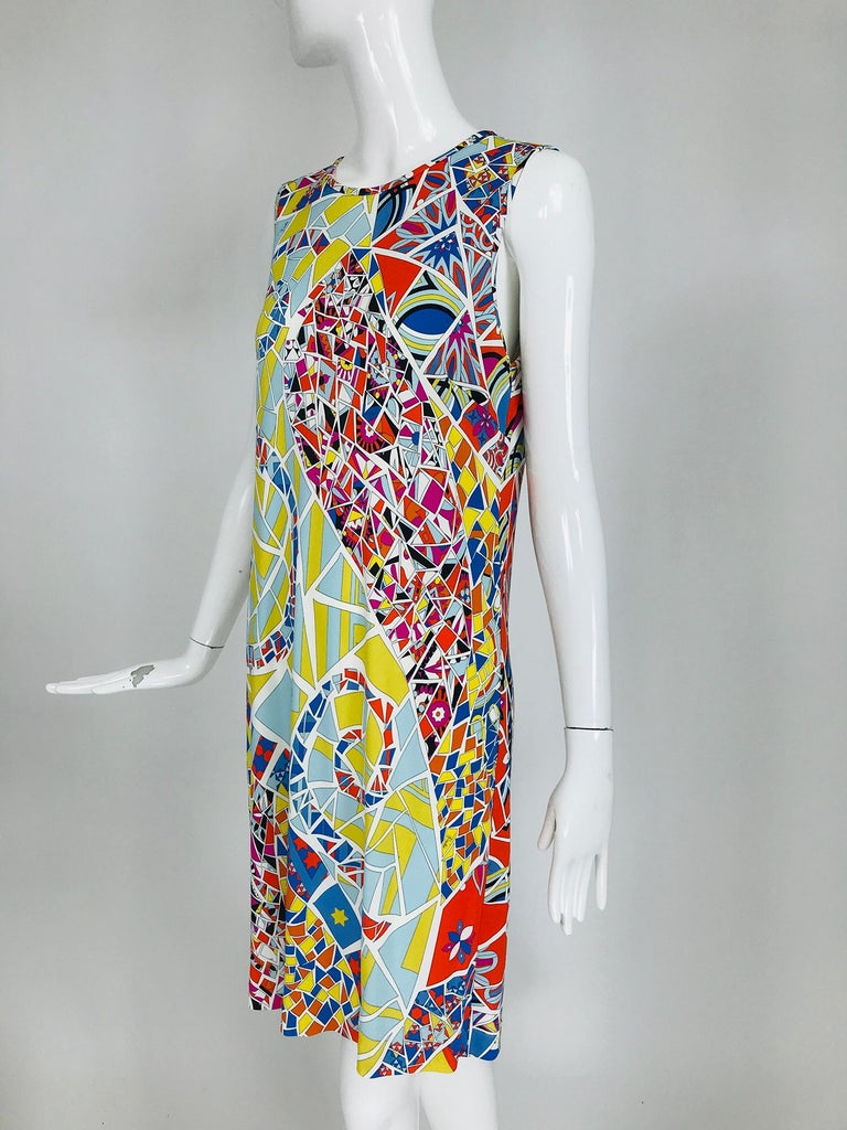 Emilio Pucci silk & rayon blend jersey, sleeveless star print shift dress marked size 42. Pull on sleeveless dress has a jewel neckline that closes at the back with a button and loop. Bold mosaic print in bright colours featuring stars. Perfect