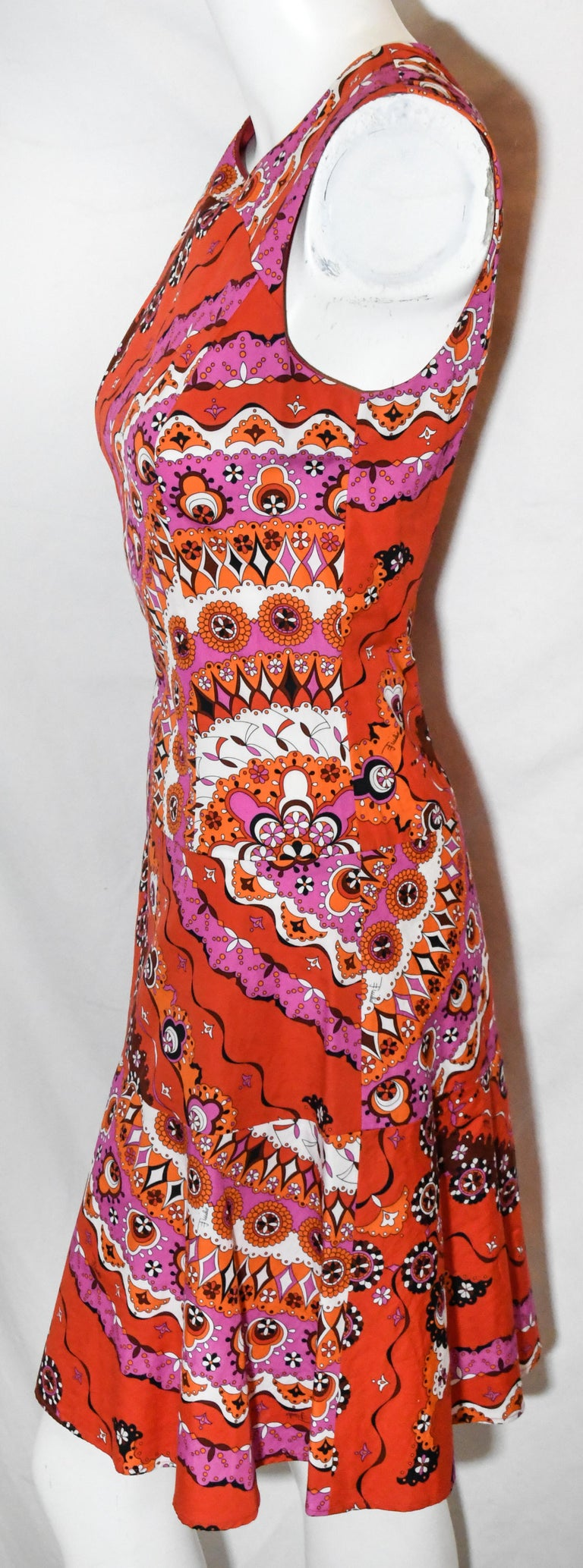 Emilio Pucci vibrant red print round neck dress includes a long gold tone zipper at back.  This dress is tapered to the body down to the hips then dress opens up to the hem.  This dress is not lined.  Dress is in excellent condition.  Made in Italy