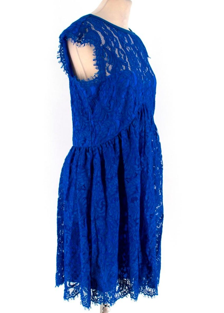 Emilio Pucci V-back blue lace dress  -Blue sheer dress with lining -Mini dress with short sleeves -Wide scoop neckline -Ruching around the waistline -Raw hem on the sleeves and hemline  Please note, these items are pre-owned and may show signs of