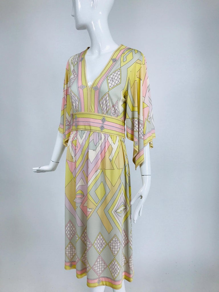 Emilio Pucci vintage silk v neck kimono sleeve day dress. Gorgeous soft colours in a geometric design. Pull on dress has a deep v front, the kimono sleeves are square and elbow length and open from the under arm seam to edge of sleeve end. A curved