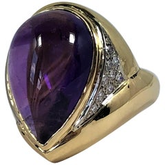 Emis Beros Pear Shape Cabochon Amethyst, Gold and Diamond Ring