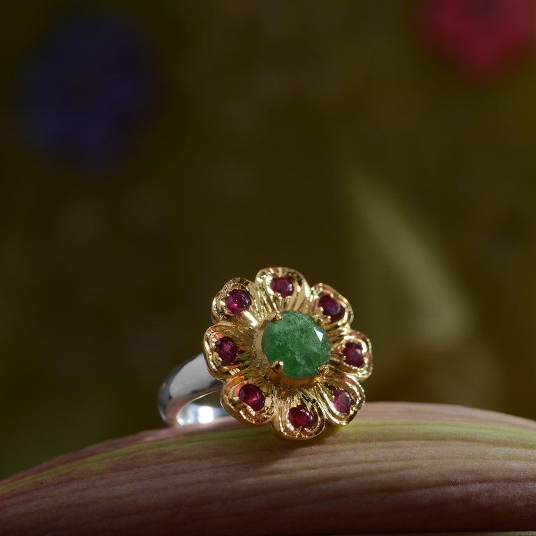 This lovely ornate ring has been handmade in our workshops. It has intricate hand engraving work on it and is embedded with an aventurine surrounded by rubies. The ring is made in sterling silver coated with 24ct gold vermeil.  25mm x 25mm Sizes -