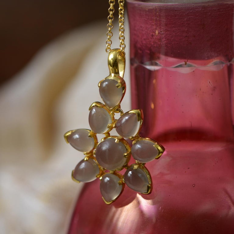 This striking statement pendant has been handmade in our workshops. The black moonstones have been hand cut especially for the pendant. It is made in sterling silver coated with 24ct gold vermeil and comes with a 20 inch gold vermeil chain. Please