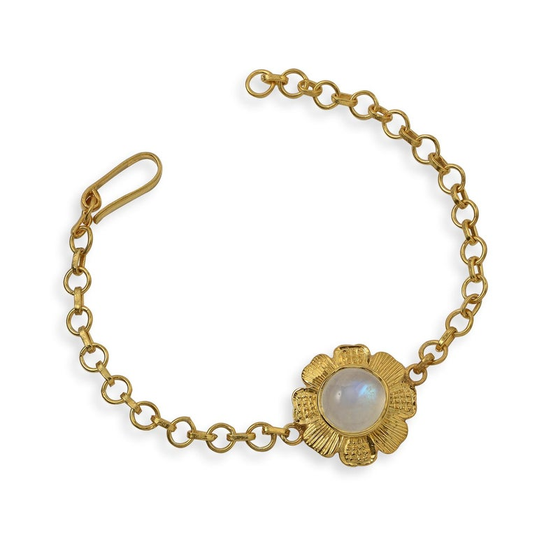 This pretty Emma Chapman Moonstone Gold Plate Bracelet, has been handmade in our workshops. It features a central cabochon rainbow moonstone, which is set in exquisite hand engraving work. The bracelet is adjustable and is made in sterling silver